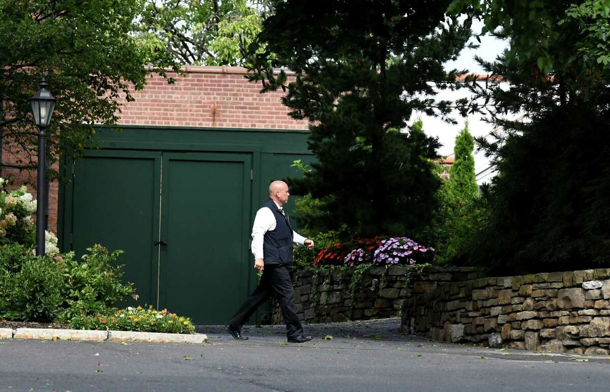 A member of Gov. Andrew M. Cuomo's State Police security detail walks through the Executive Mansion compound on Friday, Aug. 20, 2021, Albany, N.Y.