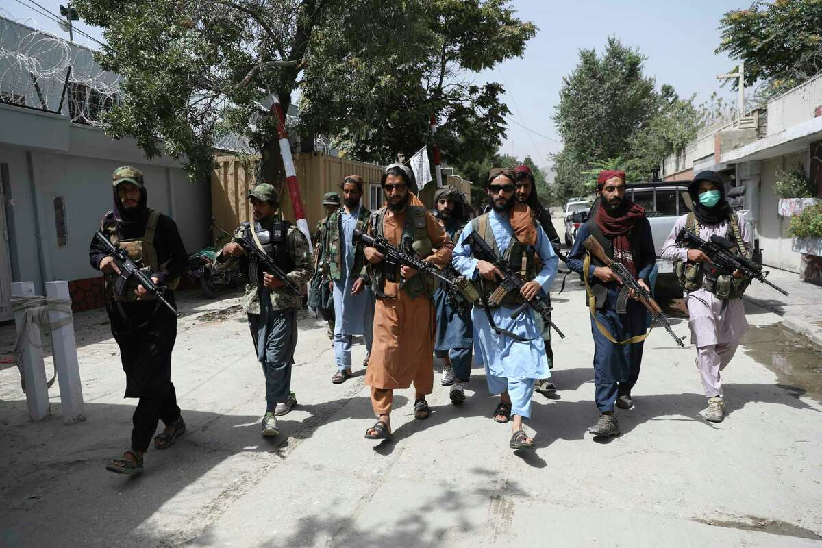 Taliban fighters on patrol in Kabul. While it is natural to want to cling to the ground many fought to gain, no amount of outside money or military force will ever sufficiently make another country totally free.