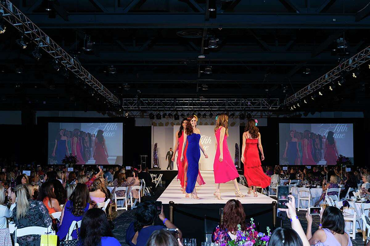 The annual Giving Goes Glam fundraiser hosted by Interfaith of The Woodlands and Junior League of The Woodlands has shifted virtual this year as local cases of COVID-19 continue to rise. Models walk the runway at the Giving Goes Glam fundraiser of 2019.