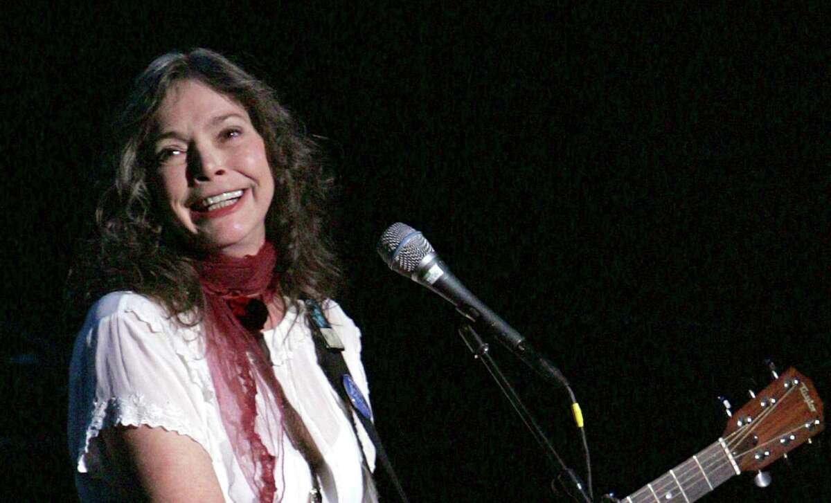 """FILE - Nanci Griffith performs during the ACLU Freedom Concert Oct. 4, 2004, in New York. Griffith, the Grammy-winning folk singer-songwriter from Texas whose literary songs like """"Love at the Five and Dime"""" celebrated the South, has died. She was 68. A statement from her management company on Friday, Aug. 13, 2021, confirmed her death, but no cause of death was provided. (AP Photo/Julie Jacobson, File)"""