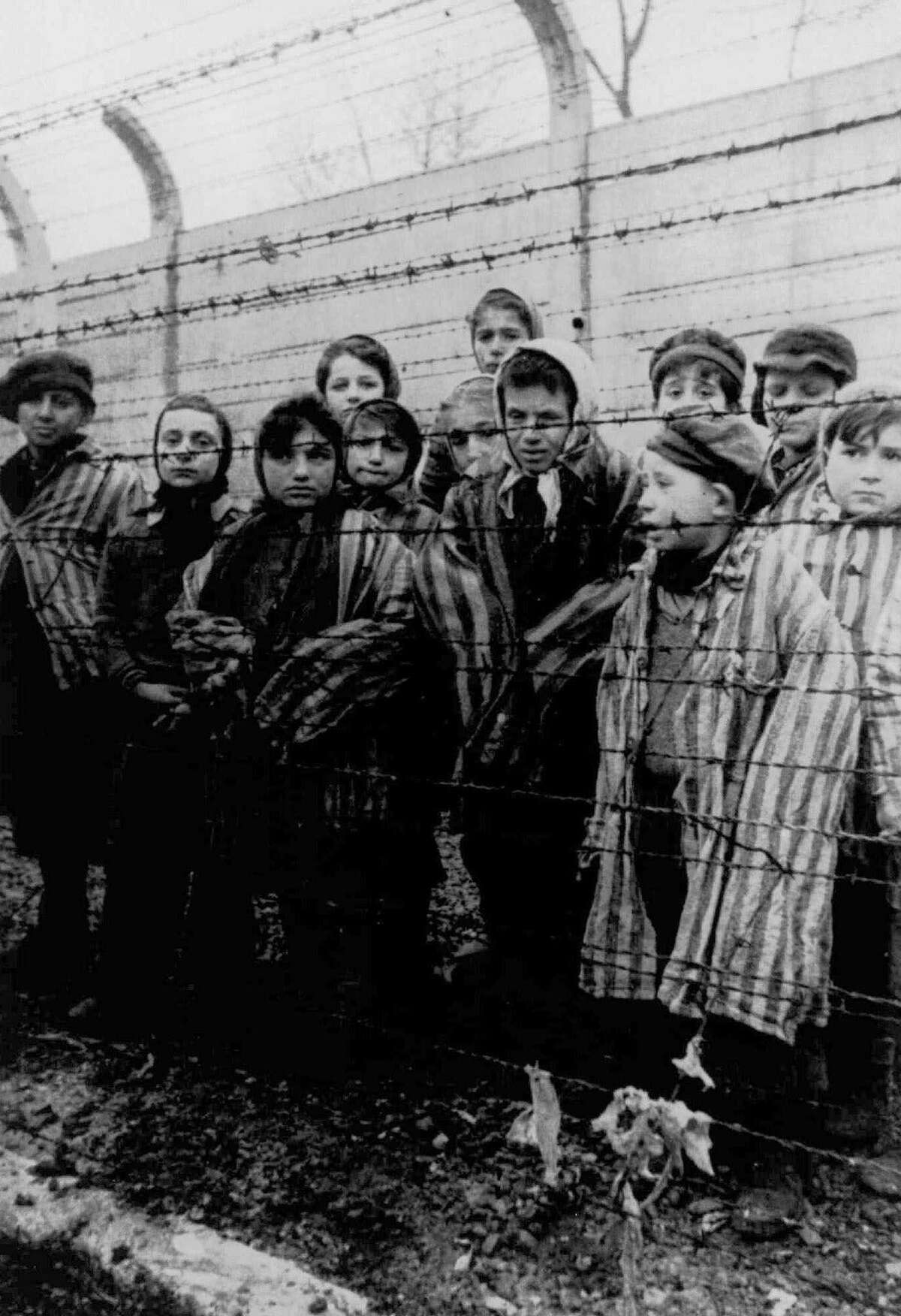 Children are liberated from Auschwitz in 1945. Why do so many public figures speak carelessly about the Holocaust? Don't they know millions were murdered?