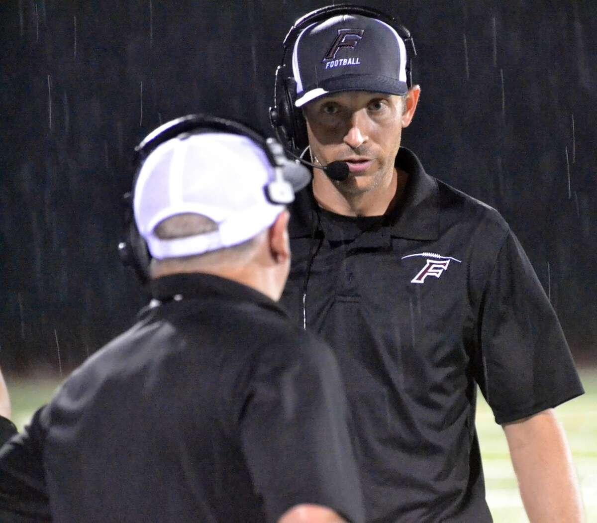 Farmington coach Chris Machol on the sideline against Platt on Sept. 6, 2018.