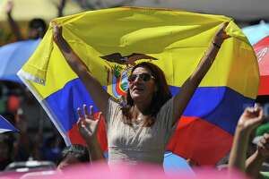 A festival-goer sports a flag of Ecuador at the Ecuadorian Festival at Ives Concert Park in Danbury, Conn. on Sunday, Aug. 11, 2013. The share of the Hispanic and Latino population in Danbury grew by 8.2 percentage points over 10 years, one of the largest increases in the state.