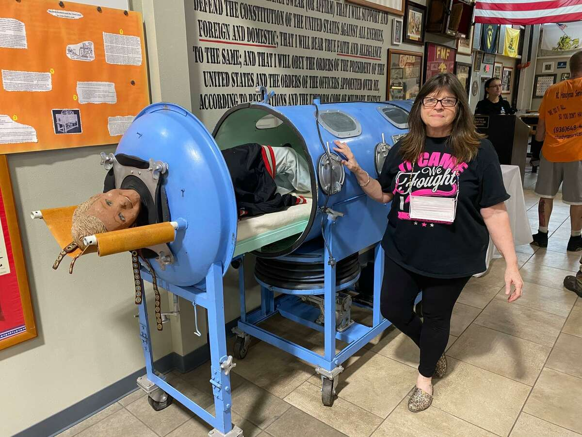 Rotary Club of Conroe member Kris Nordstrom McBride is pictured with an iron lung borrowed from one of the East Texas Rotary clubs for the Conroe club's In Spirits of Spirits of Texas in October 2020. Eradicating polio is one of Rotary's causes and iron lungs were used to treat polio patient. This year's event is set for the evening of Oct. 26 at Honor Cafe.