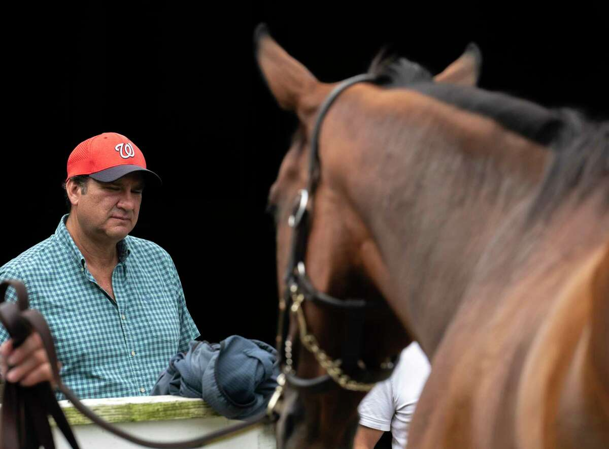 Letruska is bathed after her morning exercise by trainer Fausto Guitierrez at Saratoga Race Course on Friday, Aug. 20, 2021, in Saratoga Springs, N.Y. Letruska will be entered in the Personal Ensign next Saturday.