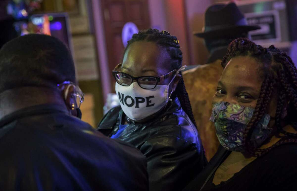 Alicia Smith and Meisha Humphrey visit Emeryville's Bank Club bar. The business is a familiar gathering place for Black residents in the city, a demographic that has quietly grown over the last decade.