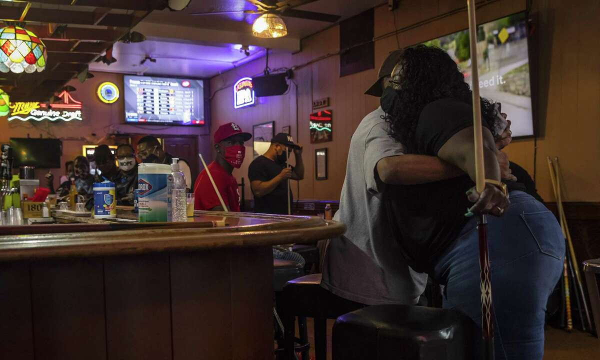 The erasure of Black culture, driven by gentrification, has been happening for decades in the Bay Area. But in Emeryville's Bank Club bar during weekly pool tournaments, the trend is hard to see. Shandle Shaw, right, and Lenny B are just some of the Black locals to regularly show up for the weekly tournament.