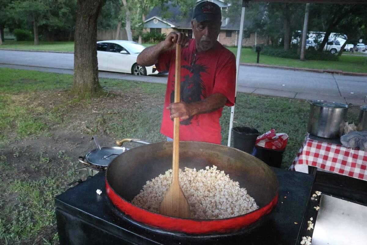 Rex Fremont mixes another batch of Native Kernel Korn for those who attended the back to school event on Aug. 12.