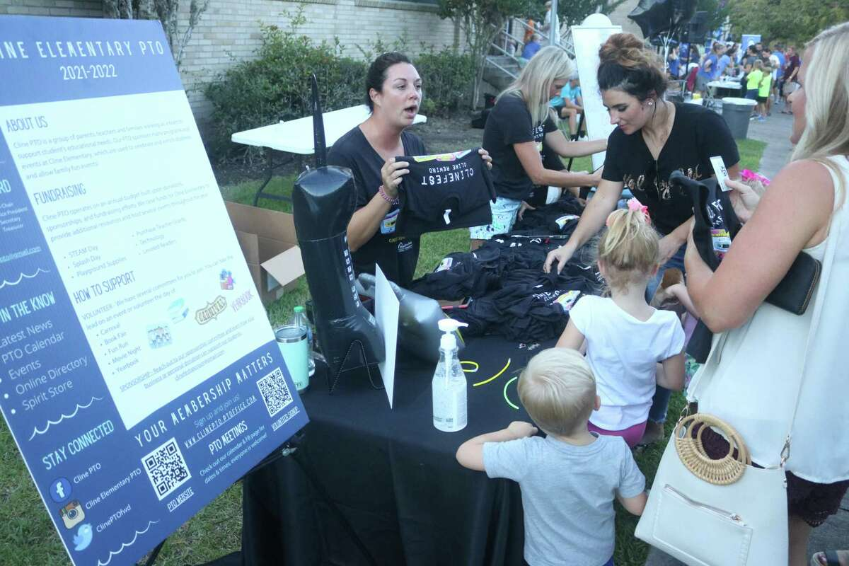 Cline Elementary's PTO was busy at their table selling school merchandise during the Under the Oaks event on Aug. 12.