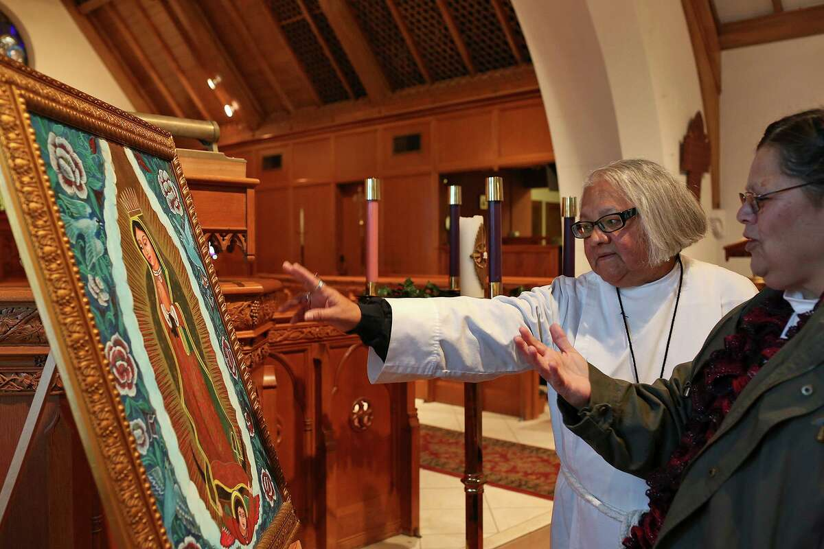 Enedina Vasquez talks about Our Lady of Guadalupe with Sister Norma Gutierrez, right, at St. Paul's Episcopal Church in San Antonio on Wednesday, Dec. 11, 2013.