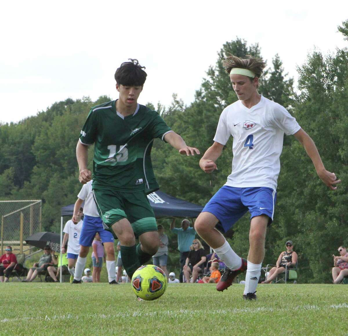 Pine River's Hoon Yang (right) battles with Jonah Fiegel of Chippewa Hills for possession of the ball during Friday night's soccer match. (Pioneer photo/Joe Judd)