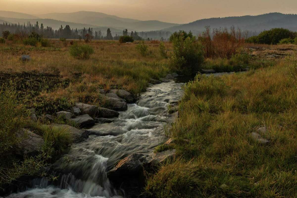A creek runs through Humbug Valley after the Dixie Fire swept through Maidu land in Plumas County, California on Thursday, Aug.19, 2021. Humbug Valley, part of the Maidu's ancestral homeland, burned when the Dixie Fire swept through the area just two years after the land was reacquired from PG&E.