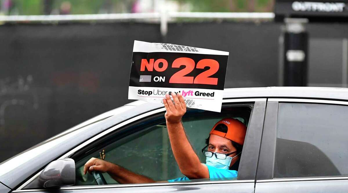 App-based drivers from Uber and Lyft protest Proposition 22 in a caravan in front of City Hall in Los Angeles in October 2020. Friday, the proposition was ruled unconstitutional.