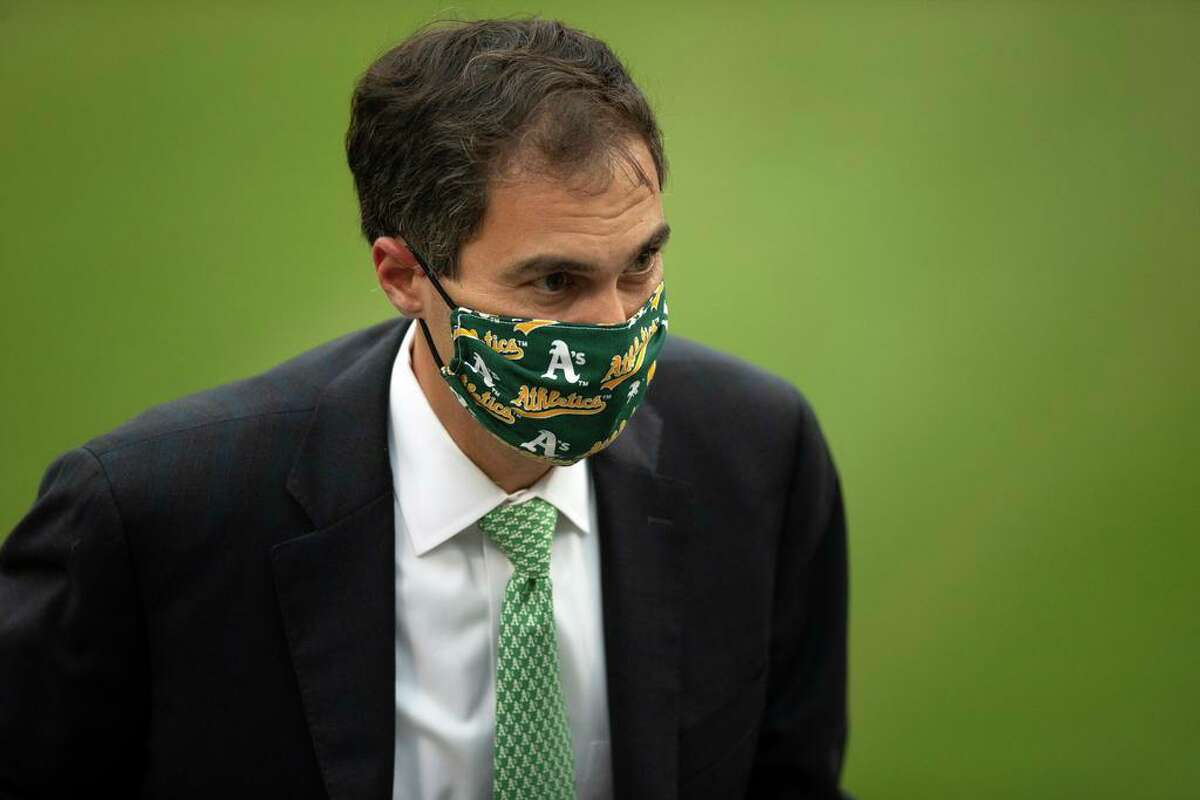 Oakland Athletics general manager Dave Kaval completes an on-air interview during the third inning of a Major League Baseball game between the A?•s and Texas Rangers on Wednesday, Aug. 5, 2020 in Oakland, Calif.