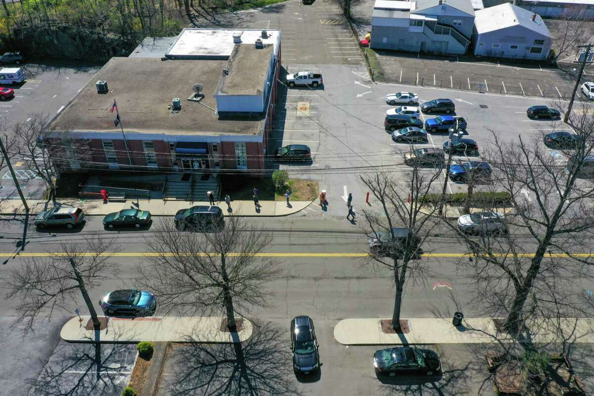 Customers line up outside the Post Office in Darien, CT.