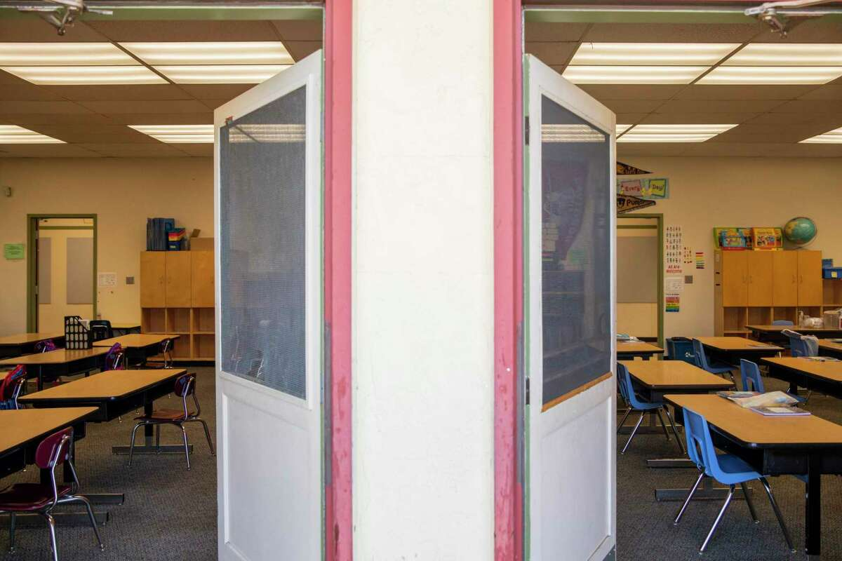 Doors to classrooms are seen opened to encourage ventilation during the first day of partial in-person instruction at Garfield Elementary School in Oakland in March. Full return to the classroom this fall has brought expected coronavirus cases and worry for parents.