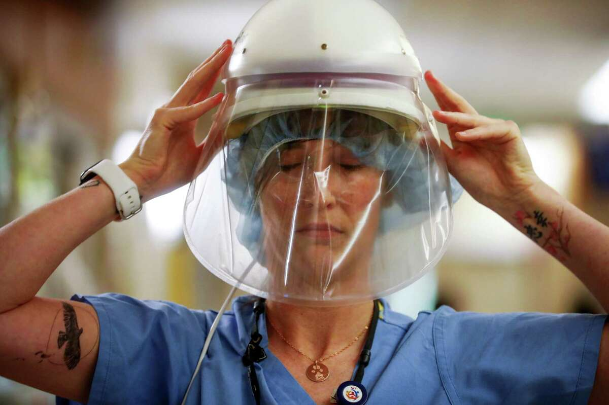 Nurse Shannon Baker prepares to see a patient in the COVID ward at El Camino Hospital in Mountain View.