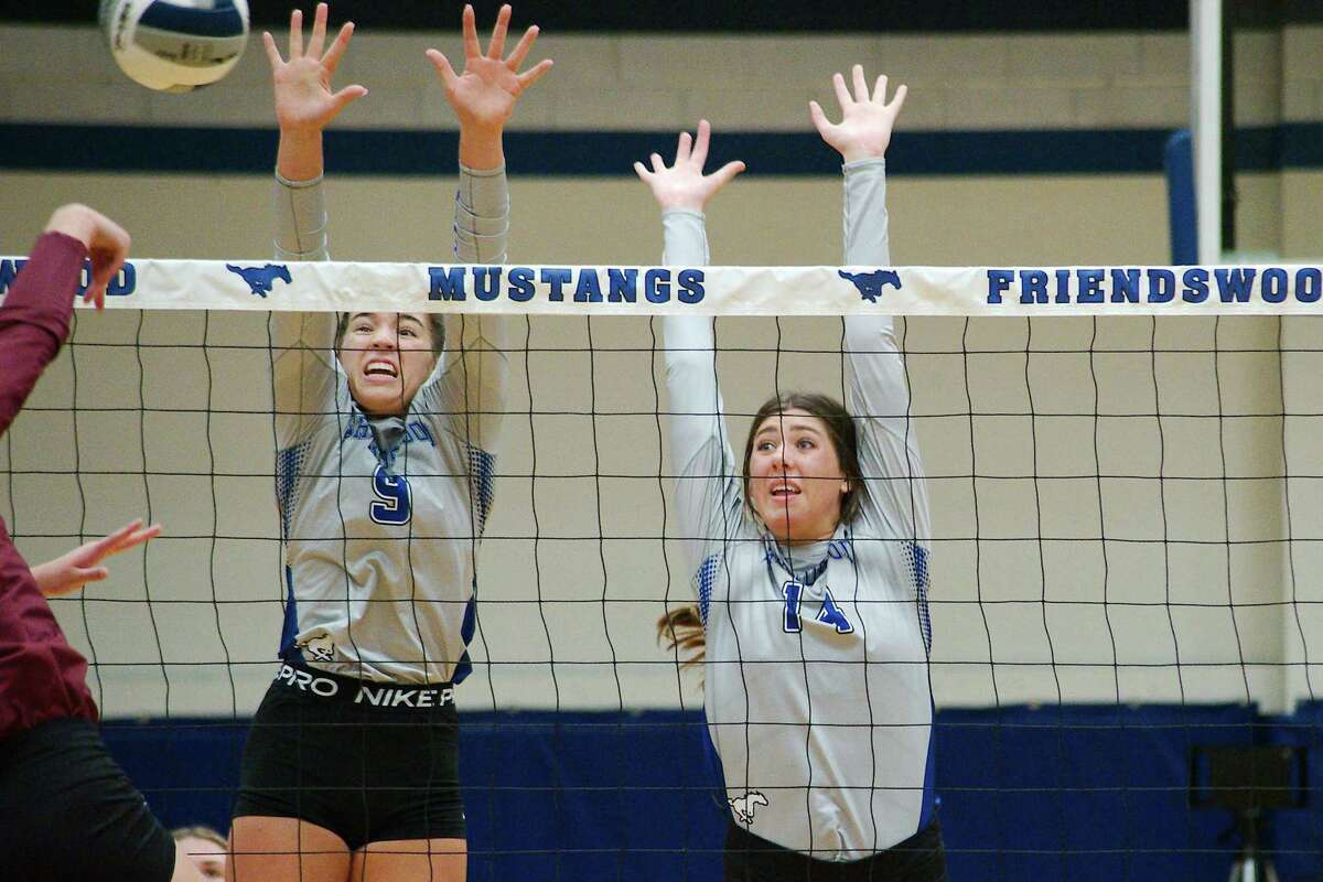Friendswood's Meghan Donoughue (9) and Isabella Thompson (14), shown against Clear Creek, were instrumental in Friday's four-set win over Clear Brook.