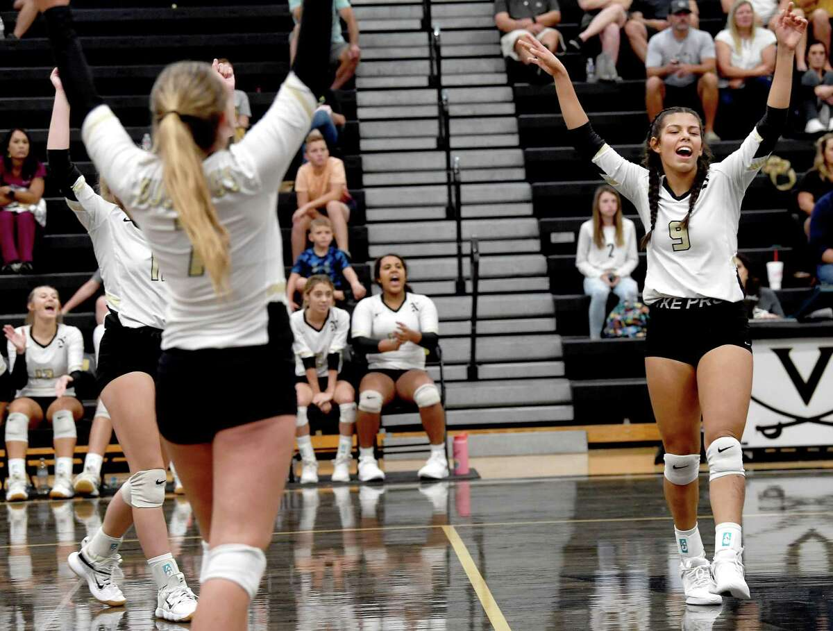 Nederland's Katie Perez and teammates celebrate as they advance against Vidor on the road Friday. Photo made Friday, August 20, 2021 Kim Brent/The Enterprise