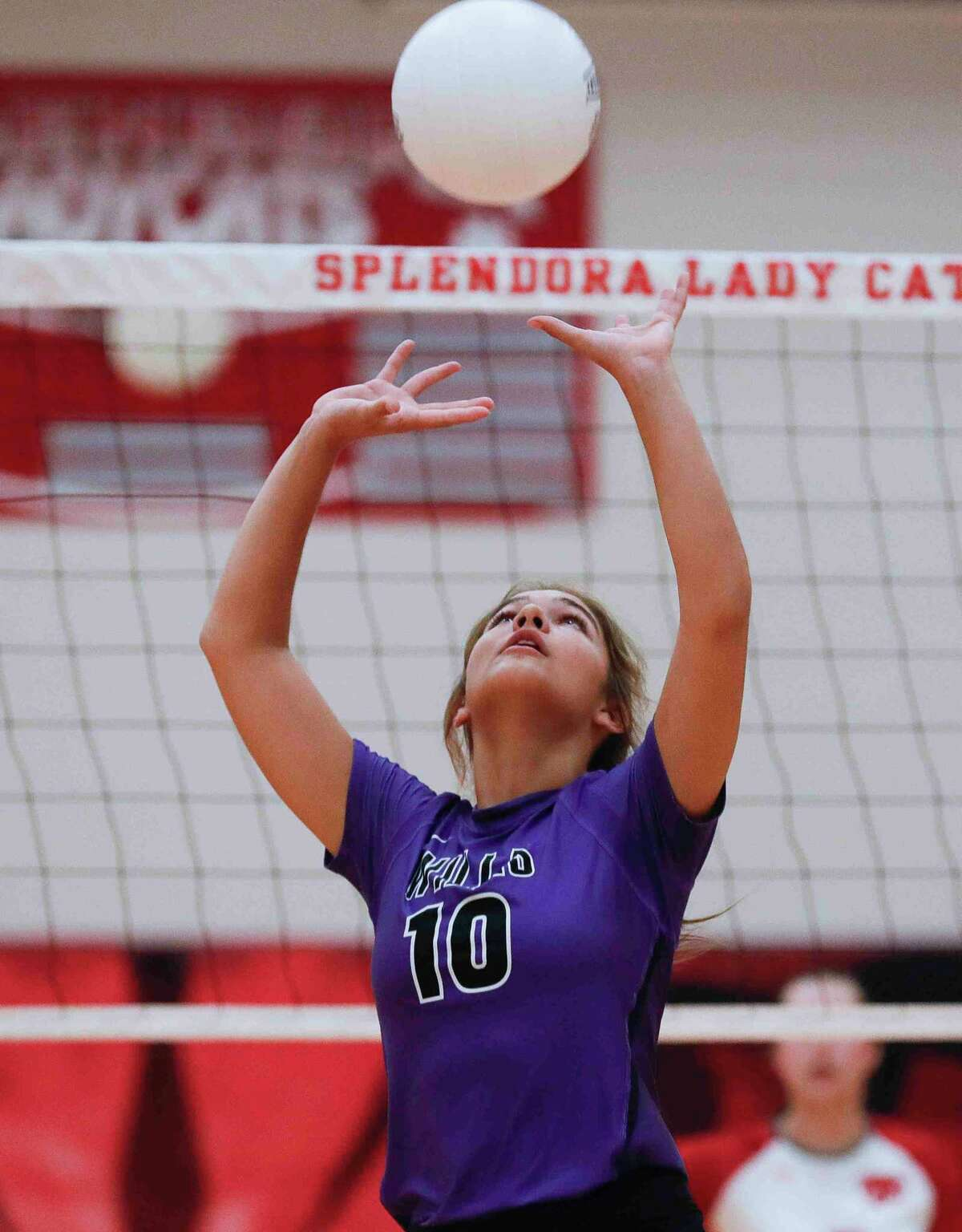 Willis' Savannah Paske (10) sets the ball in the first set during a non-district high school volleyball match at Splendora High School, Friday, Aug. 20, 2021, in Splendora.