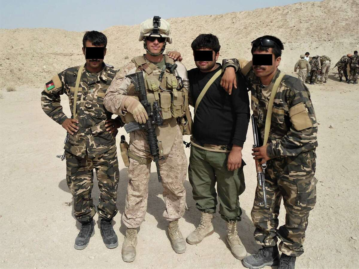 State Rep. Matt Blumenthal, D-Stamford, during a 2011 deployment to Afghanistan with the U.S. Marine Corps. He is shown with Afghan soldiers whose faces have been obscured to protect their identities after the fall of the government there.