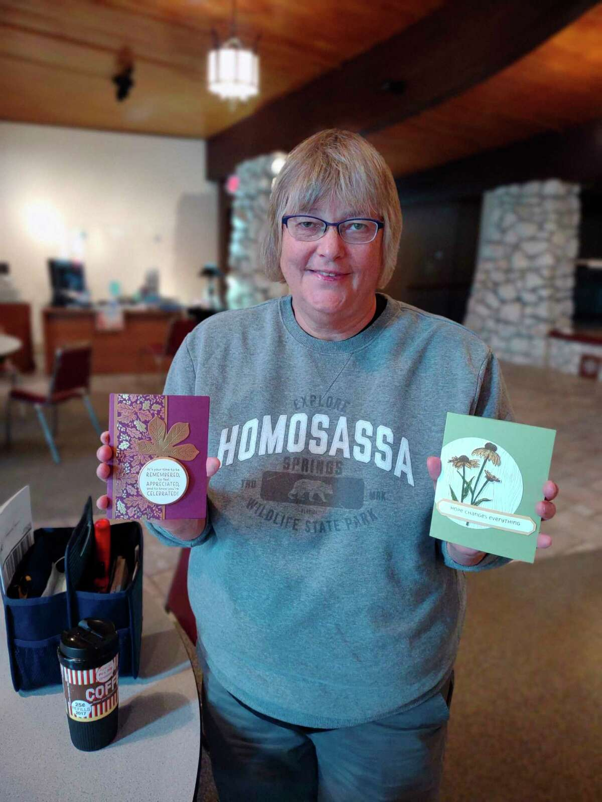 """Jill displays her handiwork, after a fun """"Card and Coffee"""" get together. The group gets together and makes handmade greeting cards once a month. (Courtesy Photo)"""