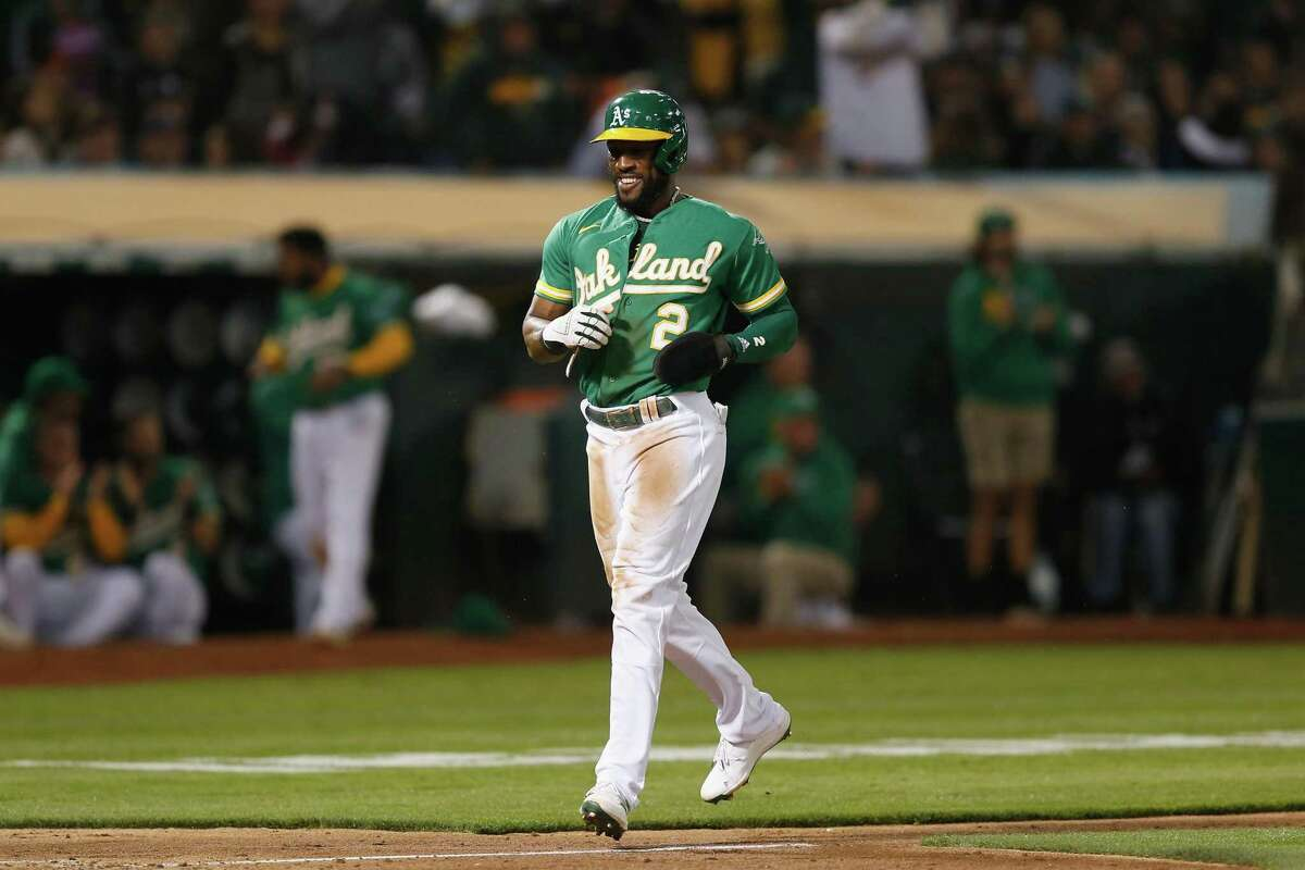 OAKLAND, CALIFORNIA - AUGUST 20: Starling Marte #2 of the Oakland Athletics reacts as he scores on a throwing error by pitcher Jose Alvarez #48 of the San Francisco Giants after stealing third base in the bottom of the seventh inning at RingCentral Coliseum on August 20, 2021 in Oakland, California. (Photo by Lachlan Cunningham/Getty Images)