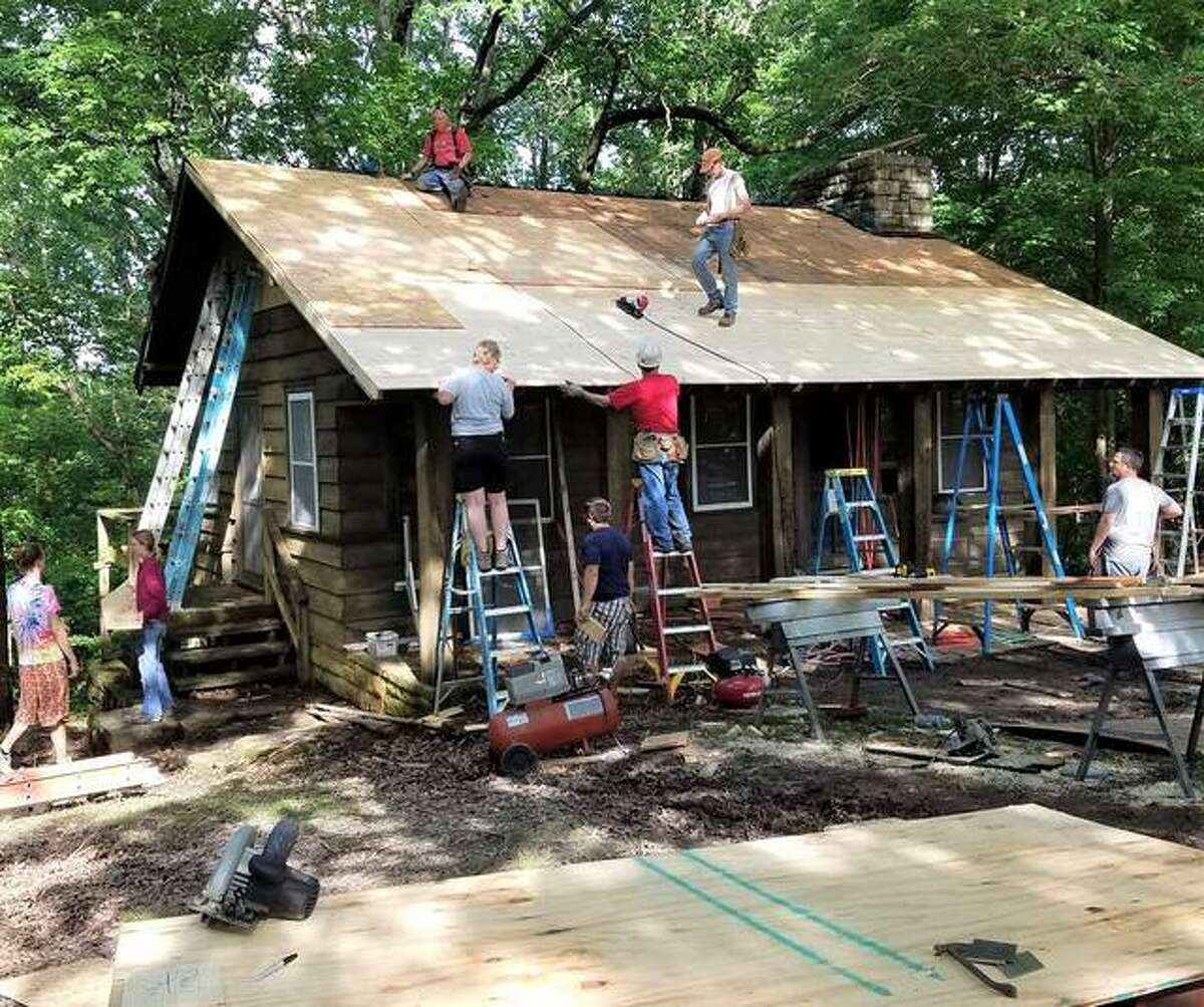 A group of volunteers help restore a cabin at Pere Marquette State Park's group camps at a past Pere Marquette Preservation Project event. The preservation project was started by the Sierra Club Illinois' Three Rivers Project in approximately 2012. This year's event will take place from Oct. 15-17. Register as a volunteer by Oct. 1 at sc.org/cabin2021 to help.