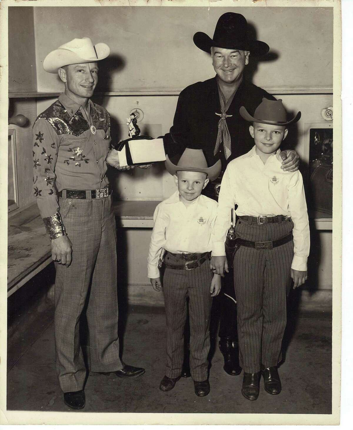 San Antonio's Municipal Auditorium hosted many shows that attracted fans of country-western music. At a Fiesta event, April 19, 1952, Del Dunbar, right, sang with the Texas Star Playboys. Backstage, he introduced his sons Bruce, left, and Errol to TV's Hopalong Cassidy, played by William Boyd, who gave out awards for a children's costume contest