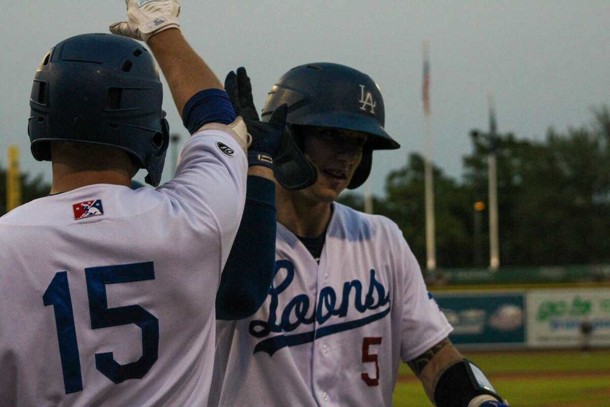 Loons catcher Ryan January celebrates with his teammates after a home run against Lansing on Aug. 20 at Dow Diamond