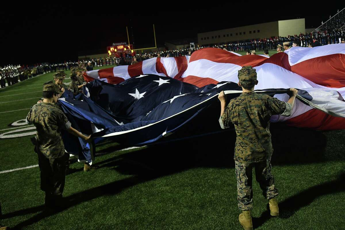 A giant American flag was unfurled during halftime of the non-district football season opener between Tomball Memorial and Tomball at Tomball Stadium on August 30, 2019.