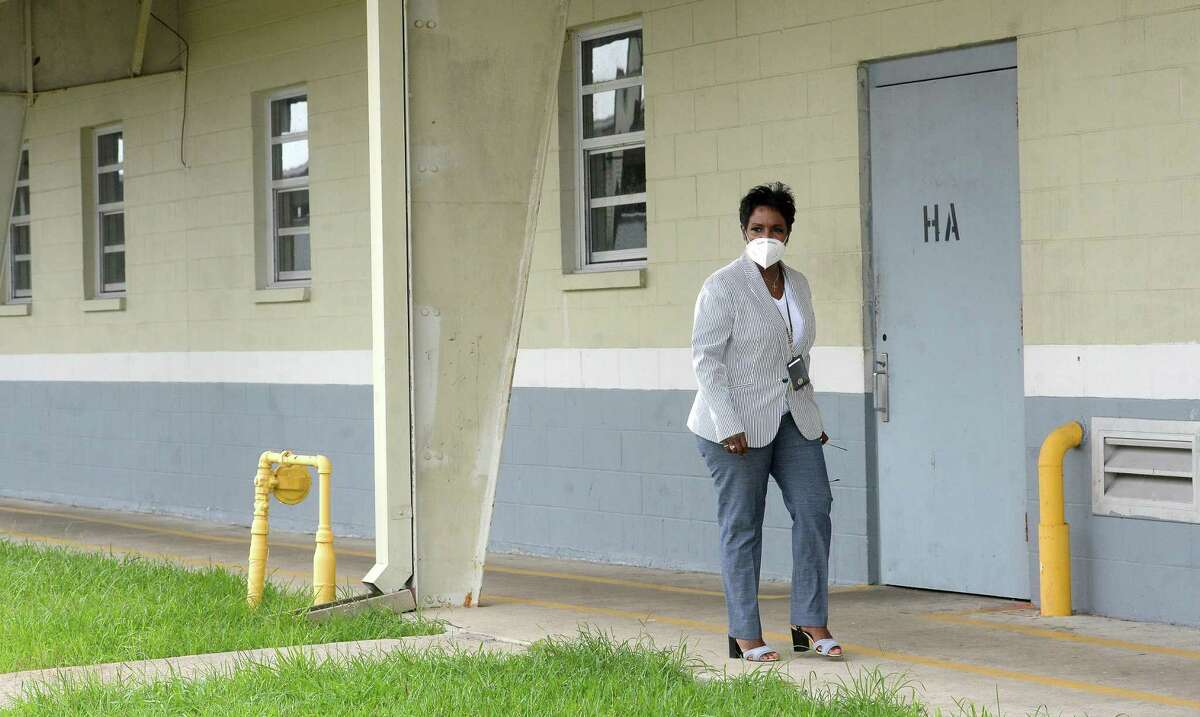 Sheriff Zena Stephens walks to one of the emptied dorms at the Jefferson County Jail, where roughly 60 of the near 700 inmates and more than a dozen employees have tested positive for COVID-19 recently. Empty dorms are being prepared to house those who are positive, and mass testing is underway at the site. Photo taken Tuesday, July 7, 2020 Kim Brent/The Enterprise