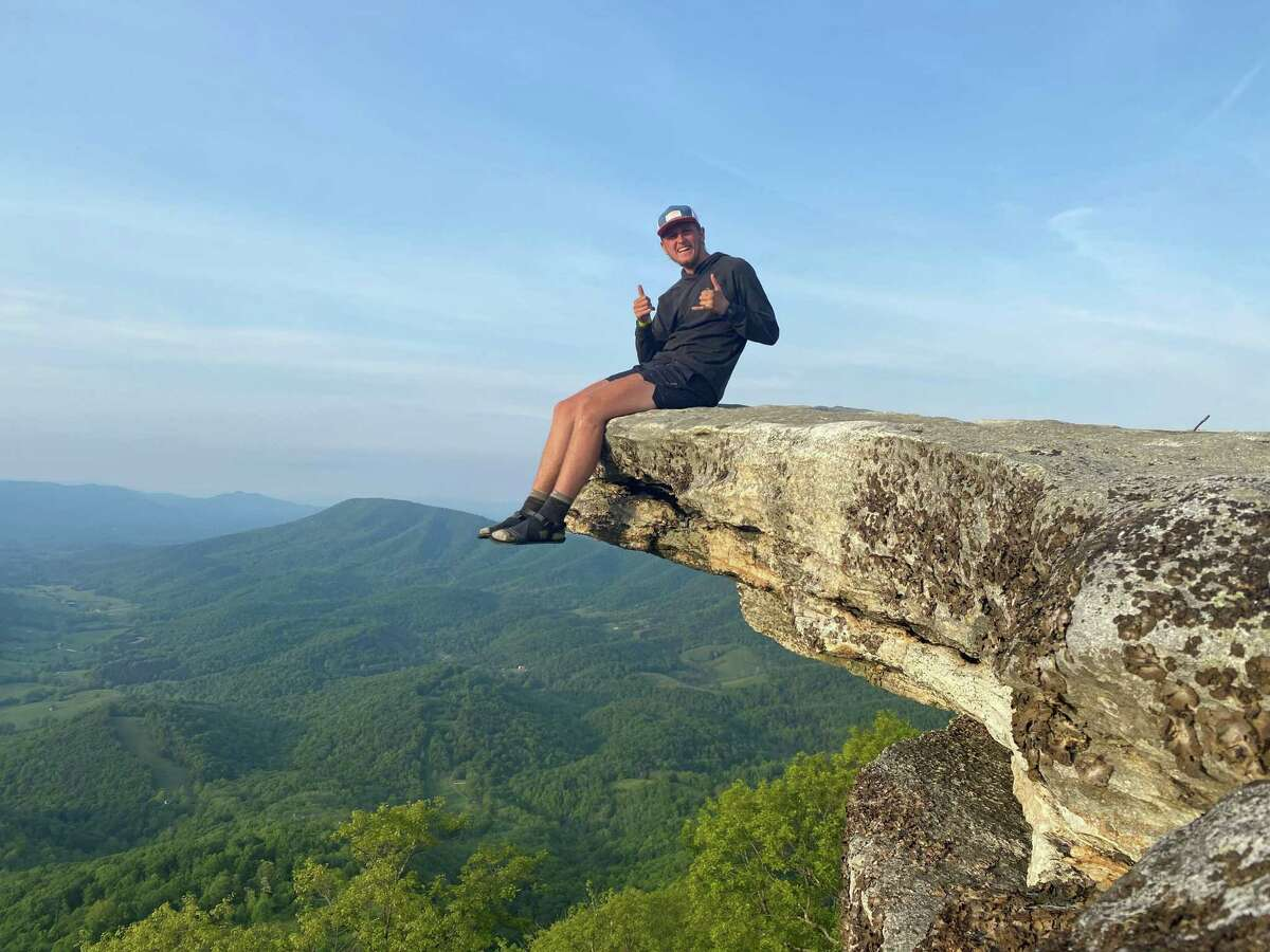 Zachary Neschich sits at McAfee Knob and admires one of the most scenic locations along the Appalachian Trail.