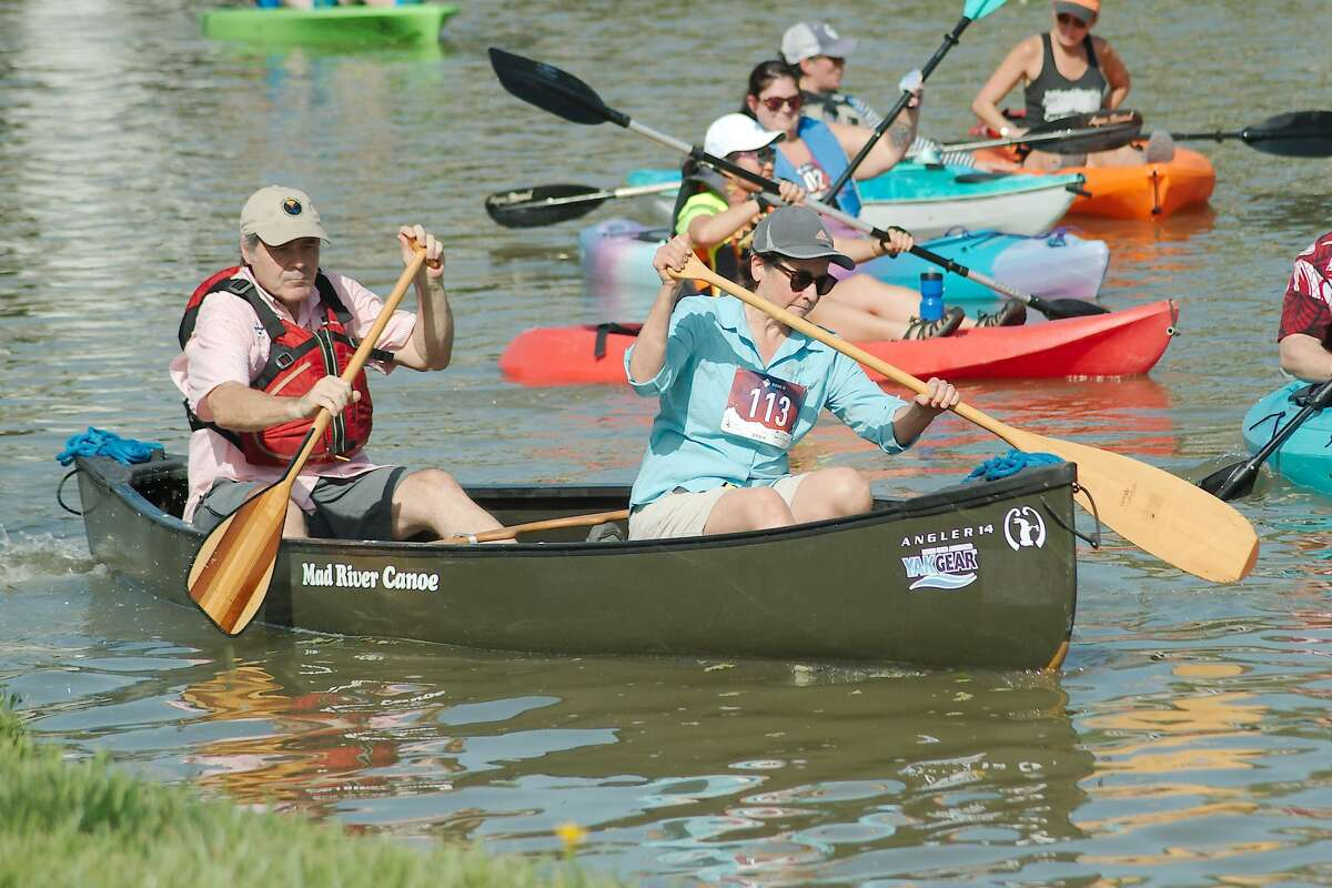 Ron and Carla Vlaskamp maneuver their canoe as they begin the 4.5 mile round trip during Clear Creek Paddle Race Saturday, Aug. 21, 2021.
