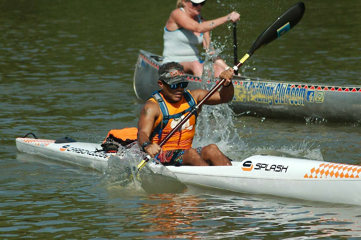 Morris Paillet paddles his kayak as the horn blows to start Clear Creek Paddle Race Saturday, Aug. 21, 2021.