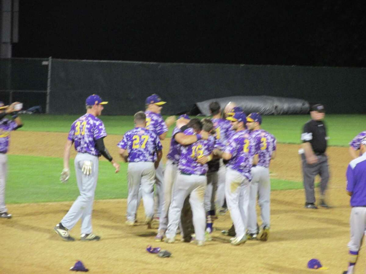 The Tri-Town Trojans swarmed Coleby Bunnell at first base Friday night after winning the Tri-State Baseball League championship over the Terryville Black Sox, dedicated to the memory of a former teammate, Coleby's brother Joe.