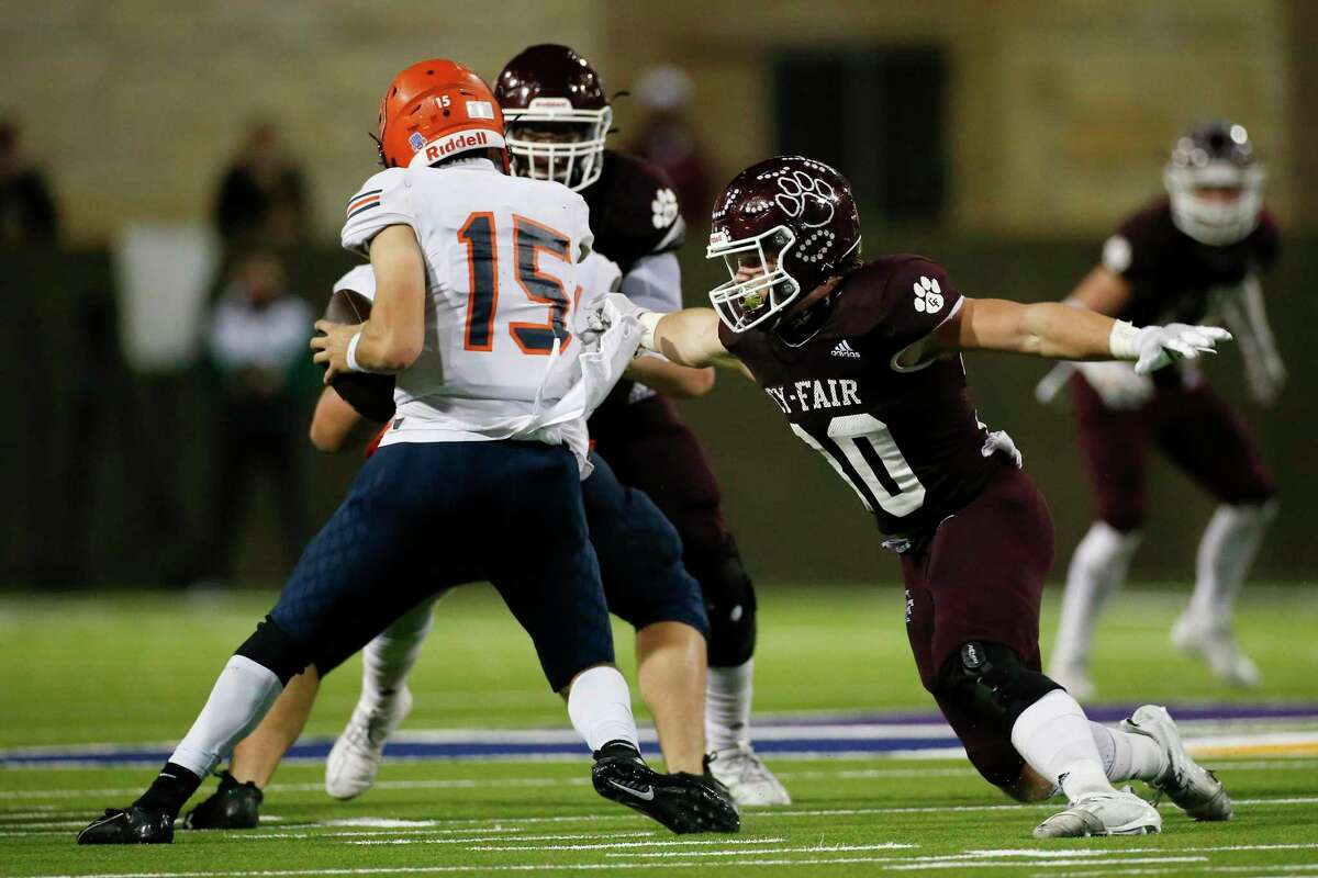 Cy-Fair Bobcats linebacker Hunter Warren (30) attempts to make a tackle during the first half of the high school football game between the Cy-Fair Bobcats and the Bridgeland Bears at Cy-Fair FCU Stadium in Cypress, TX on Friday, November 27, 2020.