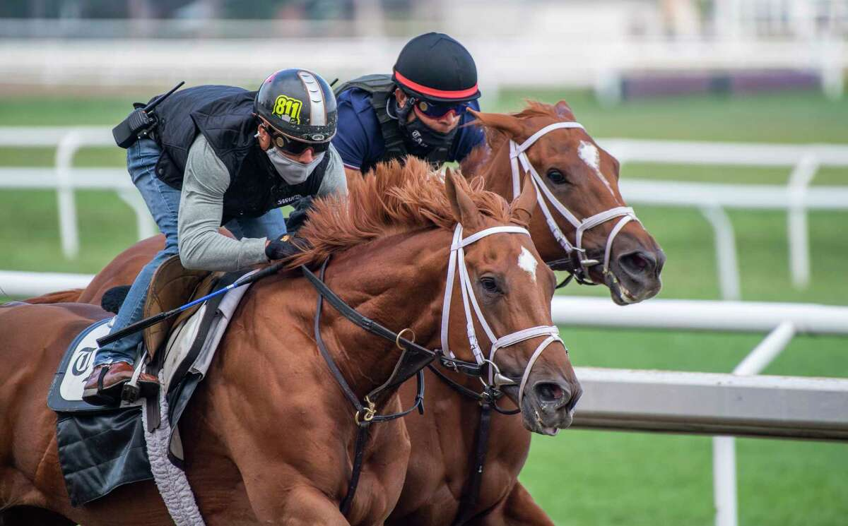 Dynamic One, left, with Irad Ortiz Jr. aboard, puts in his final speed work Saturday, Aug. 21, 2021, before his appearance in the Travers Stakes Saturday at Saratoga Race Course.