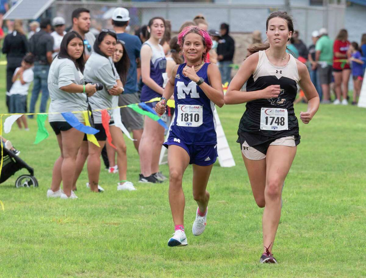 Division 1 girls Charlize Anaya, Midland High and Madeline Layton, Lubbock High race toward the finish 08/21/2021 around Hogan Park and Sibley Nature Center for the Tall City Invitational cross-country meet. Tim Fischer/Reporter-Telegram