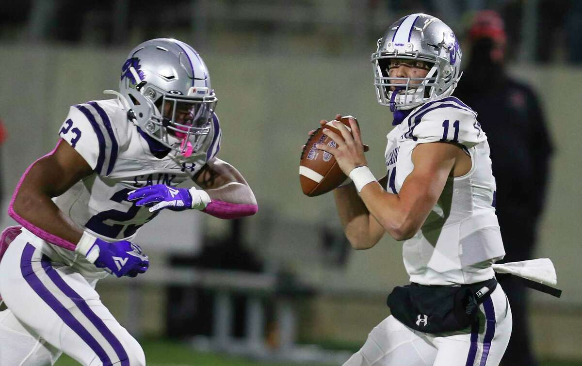 Klein Cain Hurricanes quarterback Carson Roper (11) drops back to pass against the Westfield Mustangs on December 18, 2020 in the first half at Planet Ford Stadium in Spring, TX.