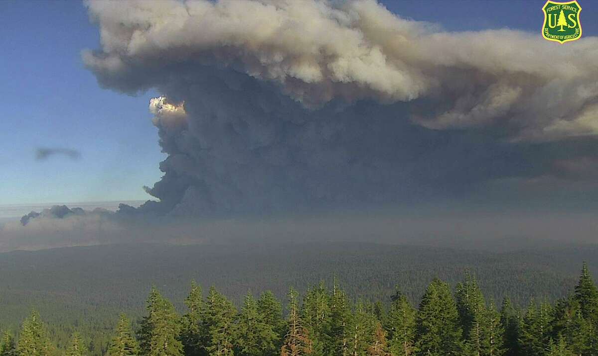 In this file image from a U.S. Forest Service wildfire monitoring camera, plumes of smoke rise from the Caldor Fire in El Dorado County, Calif., on Tuesday, Aug. 17, 2021. Smoke from the fire and the Dixie Fire farther north continued to send smoke drifting down over the Bay Area on Saturday, Aug. 21, 2021, though air conditions were slightly improving.