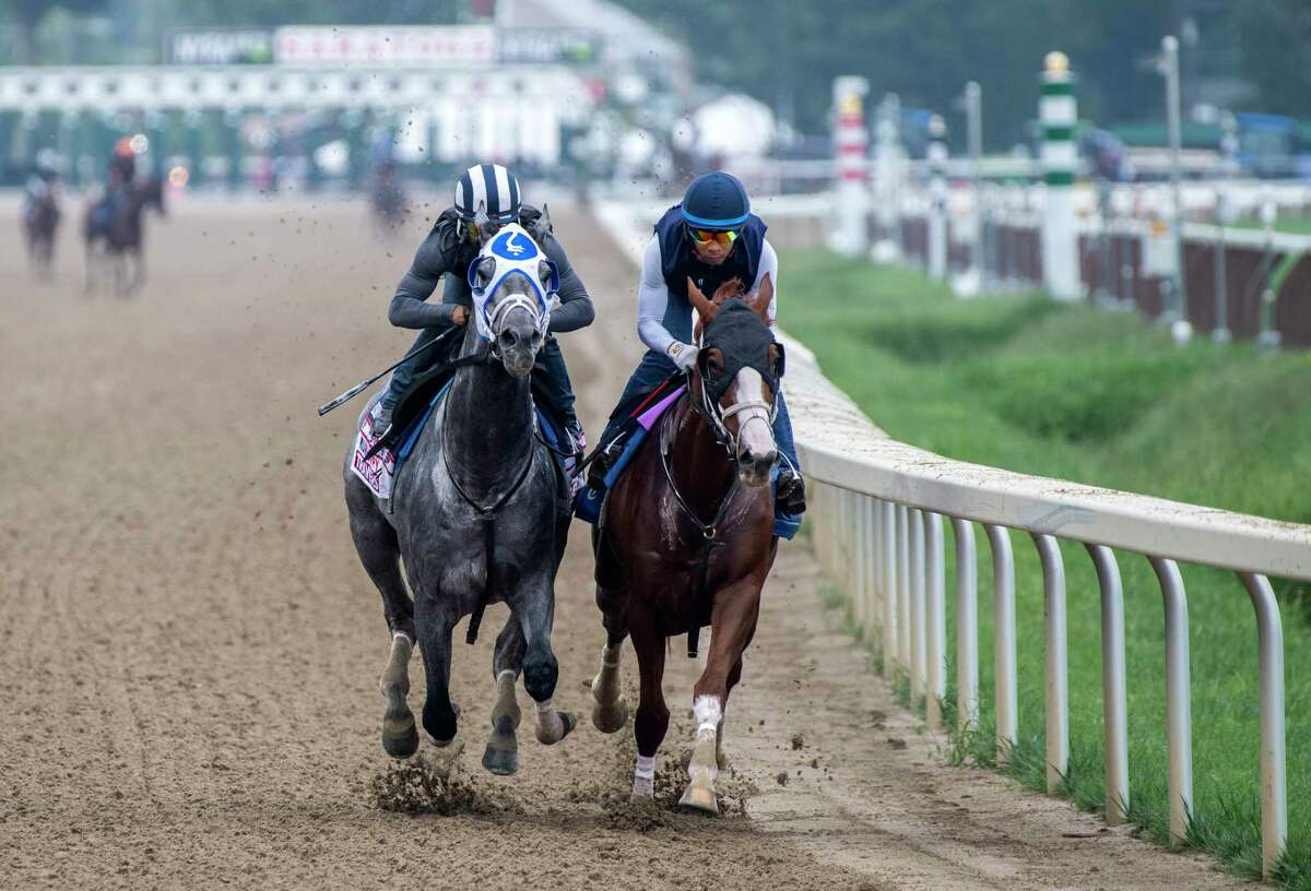 Essential Quality, with jockey Luis Saez, works in tandem with stablemate Bonny South on Saturday, Aug. 21, 2021, during his final speed work before his appearance in the Travers Stakes.