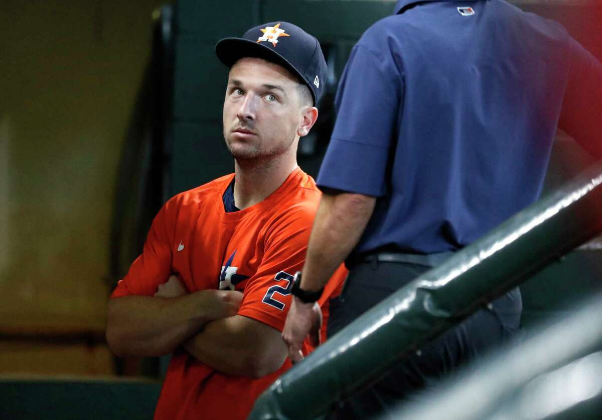 Houston Astros Alex Bregman, who has been rehabbing recently at the Sugar Land Skeeters visits the dugout during batting practice before the start of an MLB baseball game at Minute Maid Park, Saturday, August 21, 2021, in Houston.