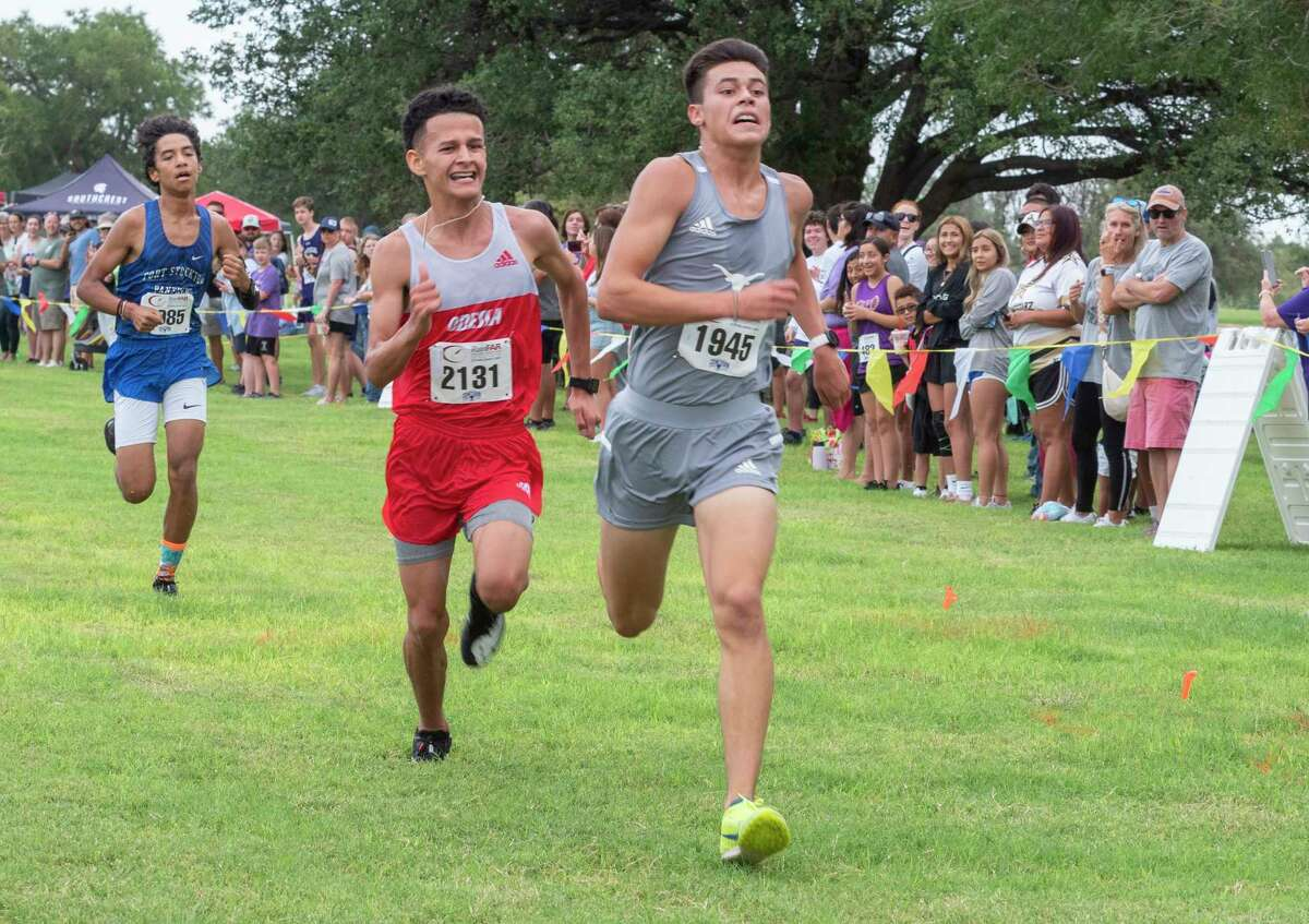 Division 1 boys Adrian Solis, Big Spring and Odessa High's Joseph Flotte race toward the finish 08/21/2021 around Hogan Park and Sibley Nature Center for the Tall City Invitational cross-country meet. Tim Fischer/Reporter-Telegram