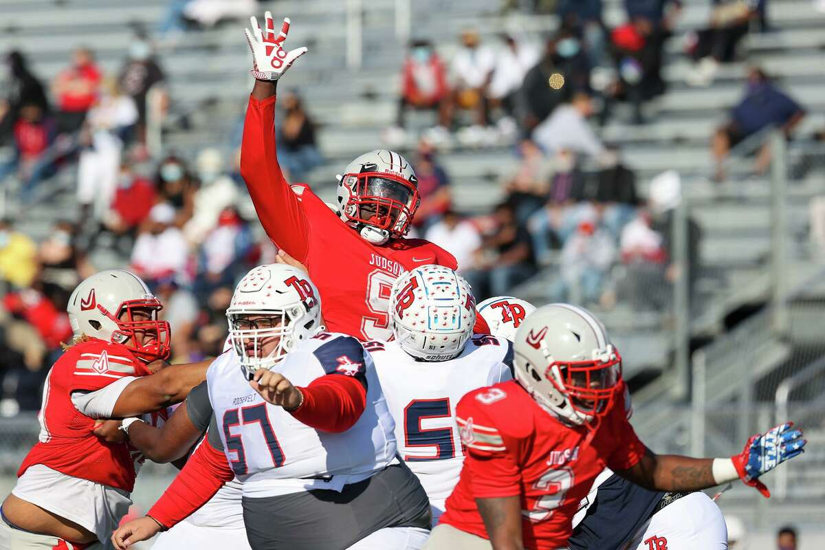 Judson's Johnny Bowens, top, goes up to try to deflect a pass during the first half of their Class 6A Division II first round high school football playoff game with Roosevelt at Rutledge Stadium on Saturday, Dec. 12, 2020.