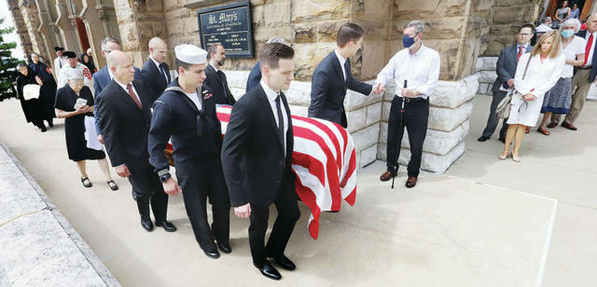 Pallbearers carry the flag draped casket of former state Sen. Bill Haine from St. Mary's Catholic Church in Alton Saturday following his funeral. Haine, 77, who died on Monday, Aug. 16, spent 16 years as a state senator for the Illinois 56th District. Haine retired from the senate in January of 2019.