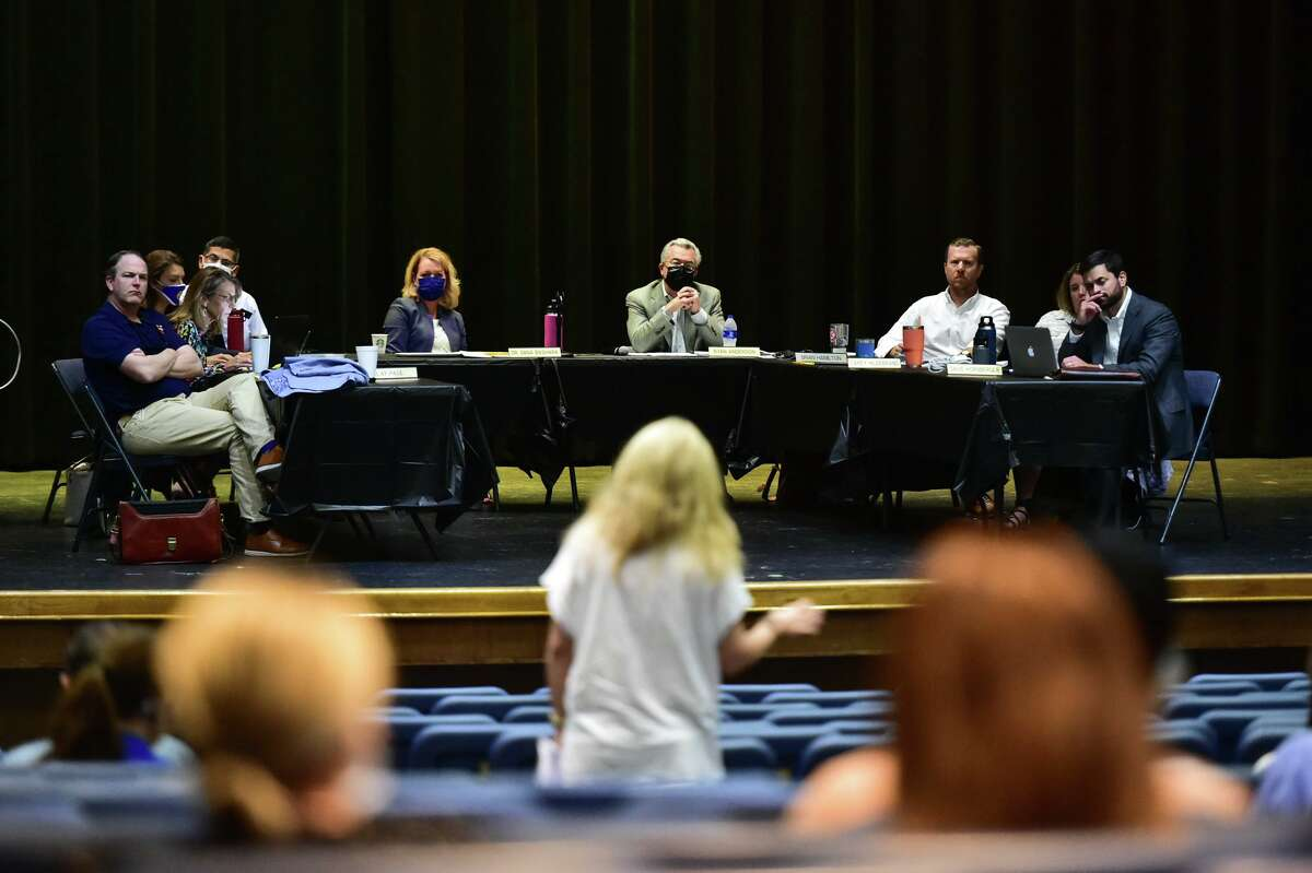 Board members and staff listen to public input Saturday morning. After two hours of public comment and 3½ three and a half hours spent in of executive session, the board voted unanimously to implement a three-week mask mandate.
