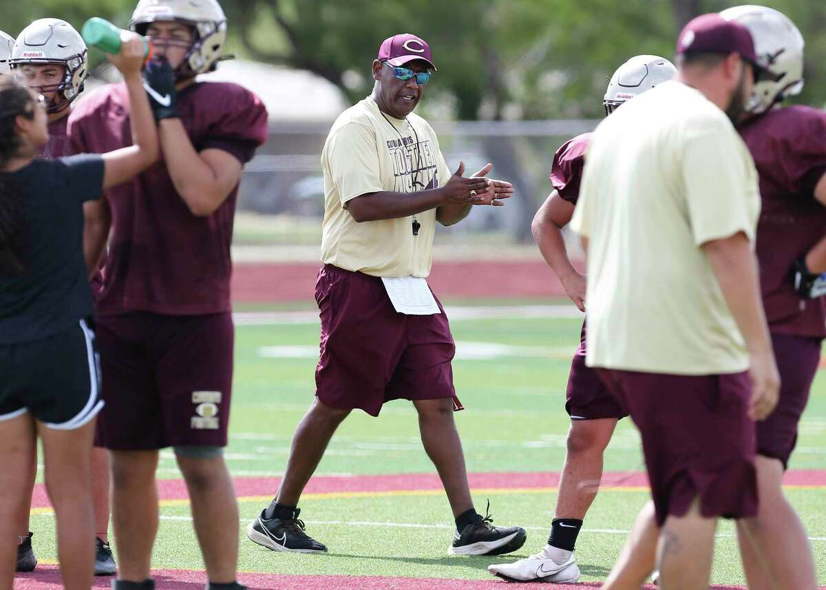 Sports profile on Cotulla football coach Marcus Booker. He was overseeing an after school practice on Tuesday, Aug. 17, 2021. Booker emerged from retirement to coach the team he led to the state semifinals in 2006. Booker felt a calling to return to coaching after his wife, Josie, died of COVID-19 last year. Booker, who played for the legendary D.W. Rutledge at Judson, also served as the head coach at South San from 2012-14.