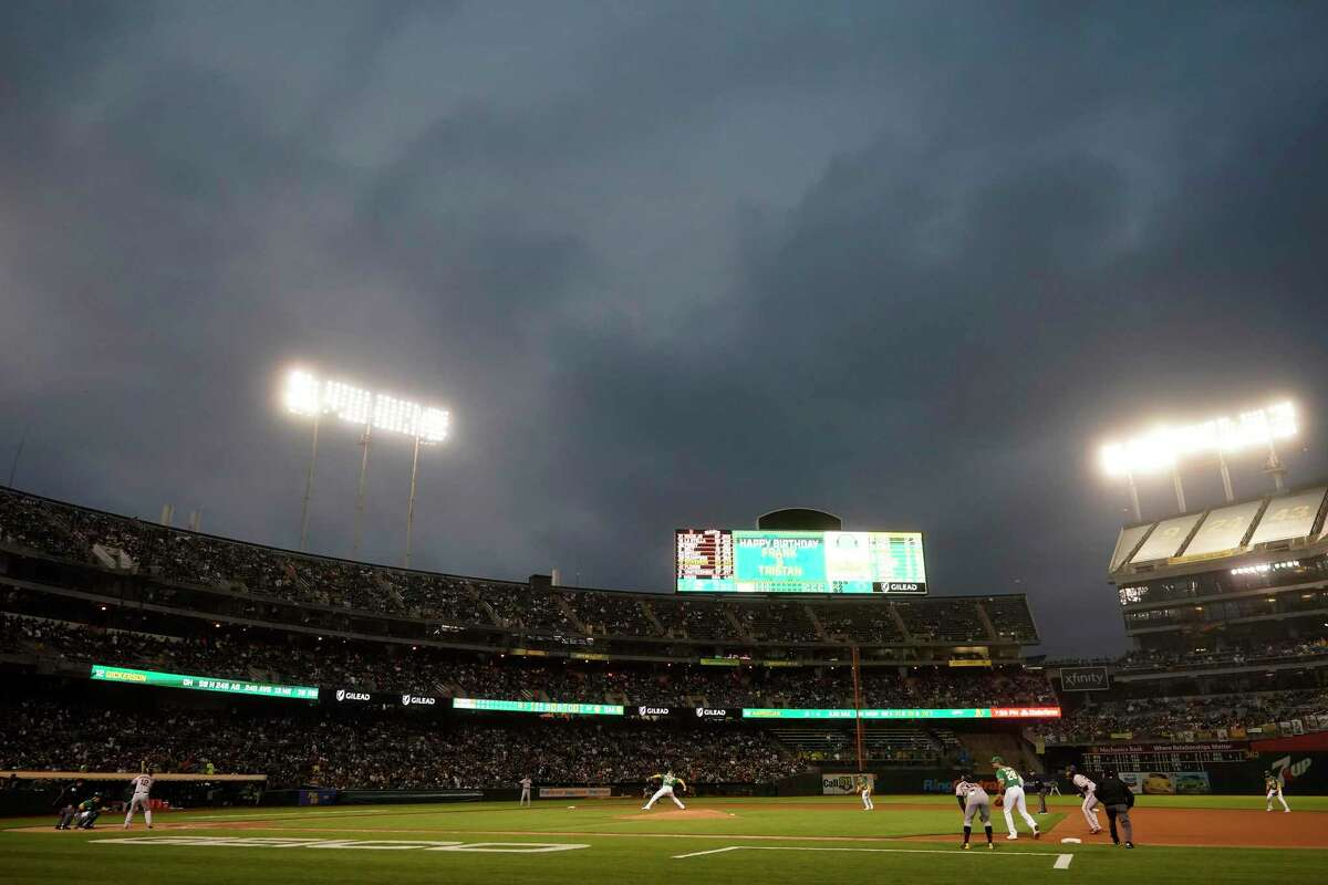Oakland Athletics' James Kaprielian, bottom center, pitches against the San Francisco Giants during the fourth inning of a baseball game in Oakland, Calif., Friday, Aug. 20, 2021. (AP Photo/Jeff Chiu)