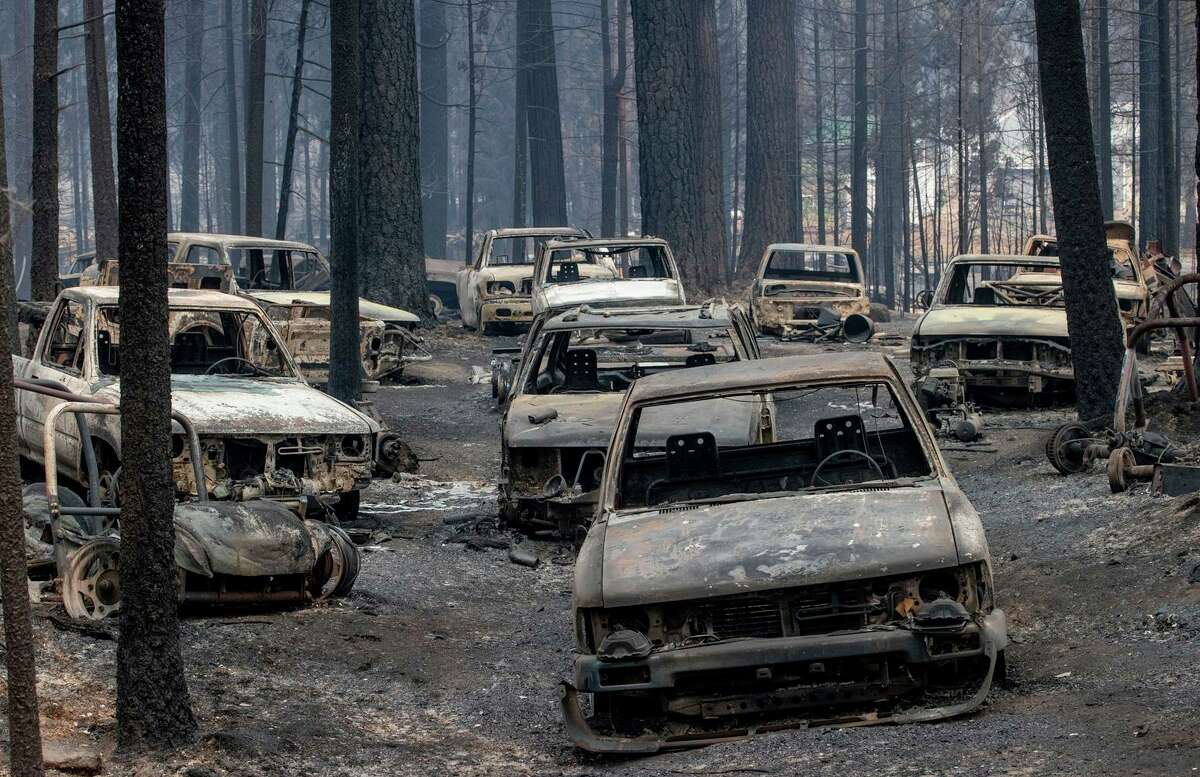 Scorched vehicles destroyed by the Caldor Fire on Evergreen Drive in Grizzly Flats (El Dorado County).